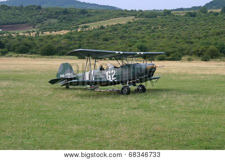 Old-fashioned biplane landed