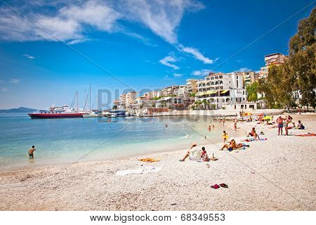 SARANDA, ALBANIA - JUNE 08, 2014: Unidentified tourists on pablic beach on  June 08, 2014 in Saranda, Albania. Saranda is one of the most important and most popular resorts on the Albanian coast.