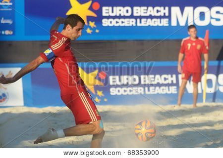 MOSCOW, RUSSIA - JULY 13, 2014: Juan Martin Lima of Spain kick the ball in the match with Russia during Moscow stage of Euro Beach Soccer League. Russia won the match 4-1 and took the first place