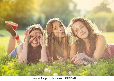Girls lying on grass