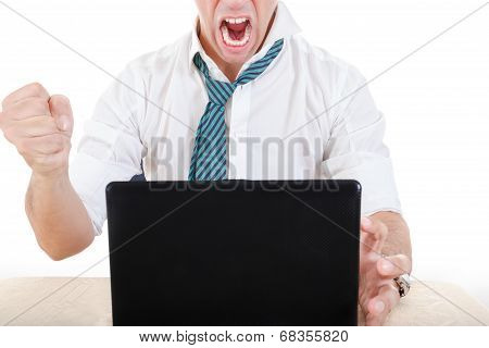 Anonymous Businessman Smashing His Laptop On Table With Fist