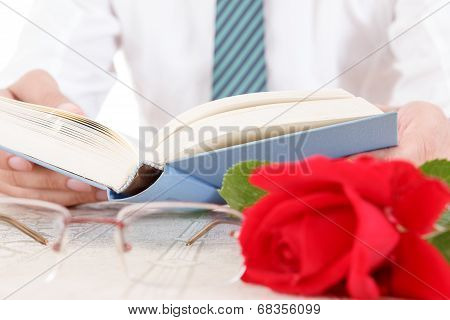 Composition With Book, Glasses And Red Rose