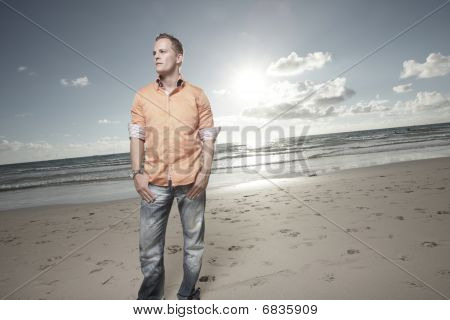 Man posing by the shore