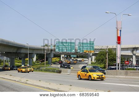 New York Taxi at Van Wyck Expressway entering JFK International Airport in New York