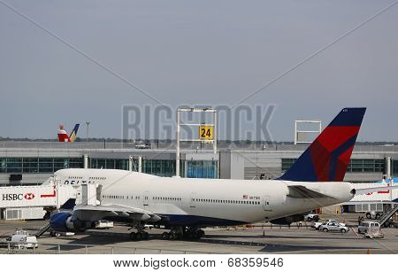 Delta Airline Boeing 747 at the gate at the Terminal 4 at John F Kennedy Airport in New York