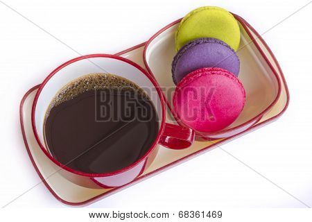 Red Cup Of Coffee And Colorful Biscuit Isolated On White Background