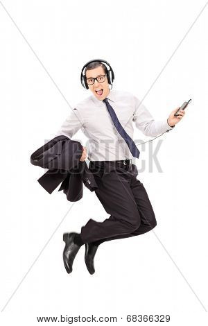 Ecstatic businessman listening to music on his cell phone isolated on white background