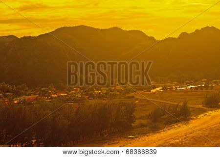 Fishing Villages Near Mountain And Sunset