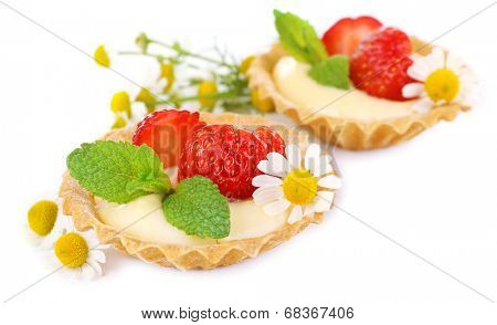 Tasty tartlets with strawberries isolated on white