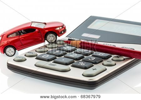 a car and a red pen is on a calculator. cost of gasoline, wear and insurance. car costs are not paid by commuter tax.