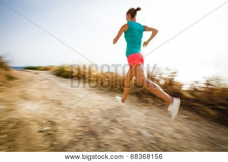 Young woman on her evening jog along the seacoast