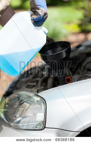 Adding Windshield Washer Fluid On A Car