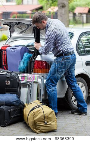 Man Packing Car For Vacation