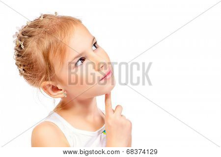 Cute smiling girl thinking about something. Isolated over white.