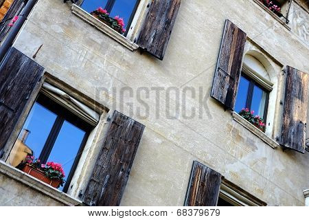 Wall of the old house with shutters