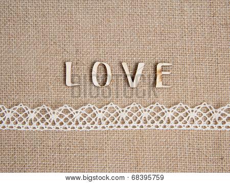 Word love over burlap