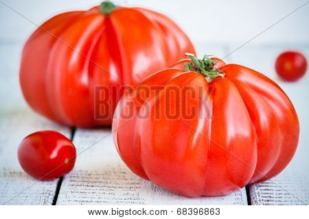 Fresh Red Heirloom Tomatoes On A Wooden Background