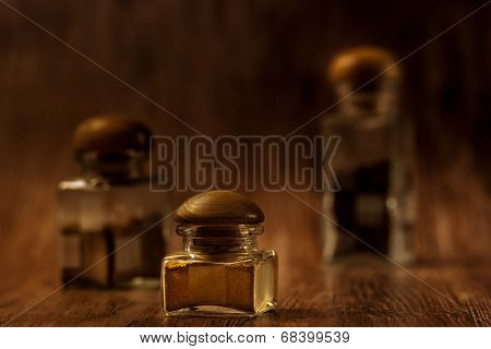Jars With Spice On Wood