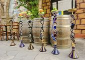 stock photo of shisha  - Six shisha aka nargile or hookah at a restaurant with fruit on top - JPG