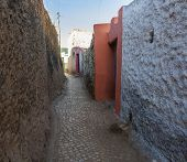 stock photo of ethiopia  - Narrow alleyway of ancient city of Jugol in the morning - JPG