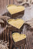 stock photo of millet  - Portion of Millet on dark wooden background  - JPG