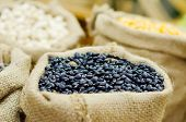 stock photo of phaseolus  - Black beans in the sack bag Phaseolus mungo - JPG