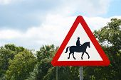pic of horse-riders  - Road sign warns of horse riders in the rural New Forest Hampshire UK - JPG