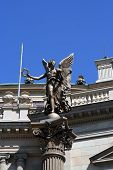 stock photo of muse  - Muse statue in front of classical style building - JPG