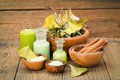 foto of salt-bowl  - herbal salt in the wooden bowl and herb on wooden background - JPG