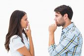 image of not talking  - Upset young couple not talking on white background - JPG