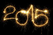 picture of sparking  - New Year 2015 formed from sparking digits over black background - JPG