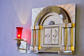 stock photo of tabernacle  - Tabernacle with lit candle representing the presence of God  - JPG