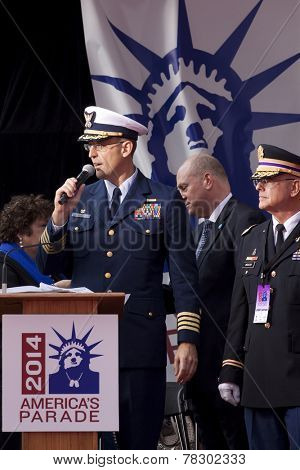 NEW YORK - NOV 11, 2014: Captain Gordon Loebl speaks to the crowd from the VIP viewing stage during the 2014 America's Parade held on Veterans Day in New York City on November 11, 2014.