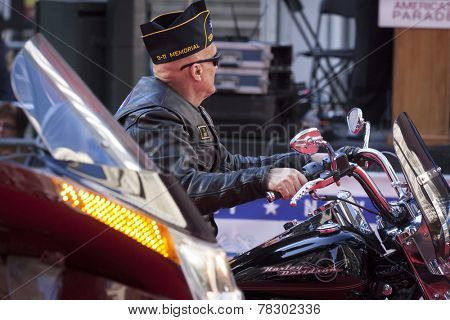 NEW YORK - NOV 11, 2014: A US vet rides a Harley Davidson in the 2014 America's Parade held on Veterans Day in New York City on November 11, 2014.