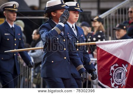 NEW YORK - NOV 11, 2014: A female captain from the US Navy salutes as she marches past the VIP stage during the 2014 America's Parade held on Veterans Day in New York City on November 11, 2014.