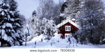 old red cottage draped in snowy winter landscape, panoramic view