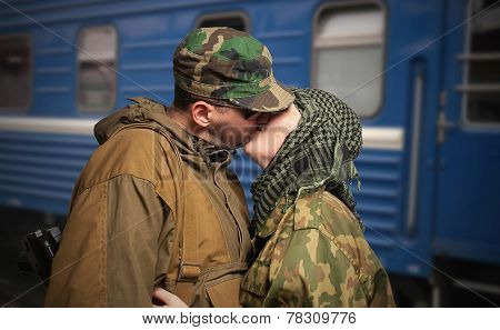 Romantic scene of farewell of wife with husband leaving on military service