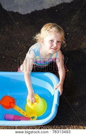 toddler girl playing in summer