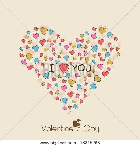 Happy Valentine's Day celebration concept with heart shape made by colorful hearts and I Love You text on beige background.
