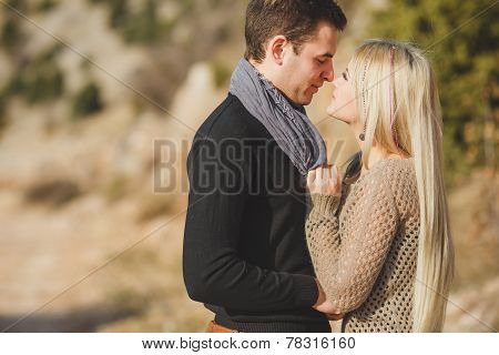 Loving couple in the mountains in autumn.