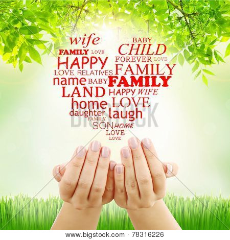 Family concept, family word cloud in hands on green background
