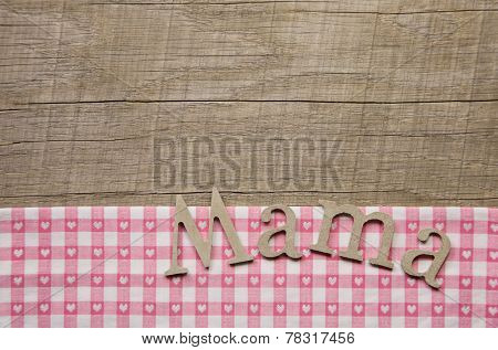 Wooden mothers day background with text mum in german language.