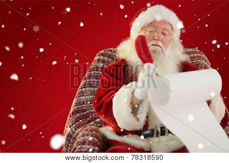 Father christmas writing list with a quill against red background