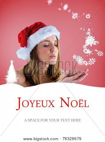 sexy santa girl blowing over hands against joyeux noel