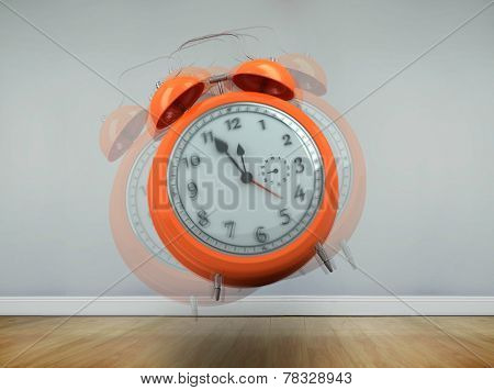 Alarm clock counting down to twelve against room with wooden floor