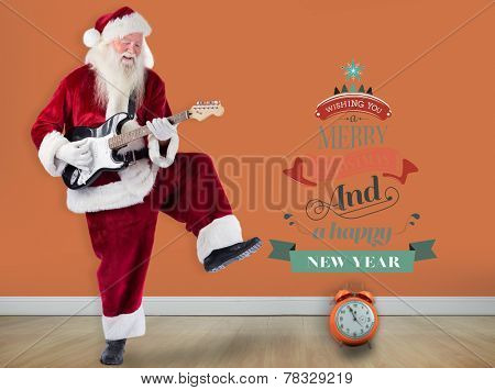 Santa Claus has fun with a guitar against room with wooden floor