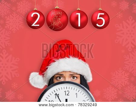 Woman worried at the time against red snowflake design frame pattern