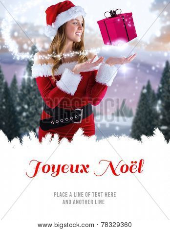 sexy santa girl presenting with hand against joyeux noel