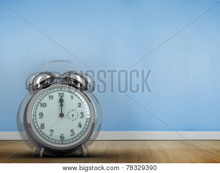 Alarm clock counting down to twelve against blue room with wooden floor