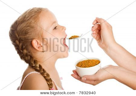 Little Girl Taking Pollen - Traditional Remedies